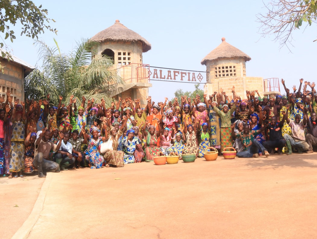 Team members of Alaffia at the gate of their cooperative.