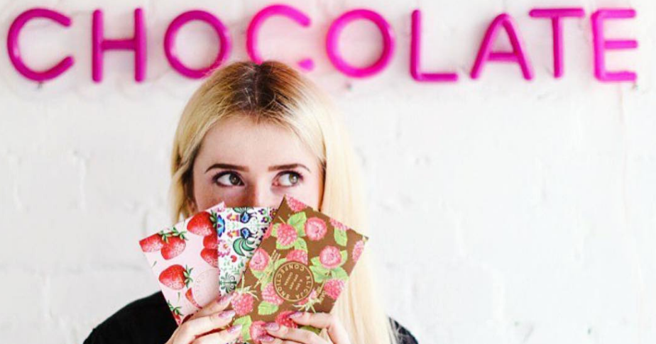Alicja Confections owner, Alicja Buchowicz poses with chocolate bars in her retail store.