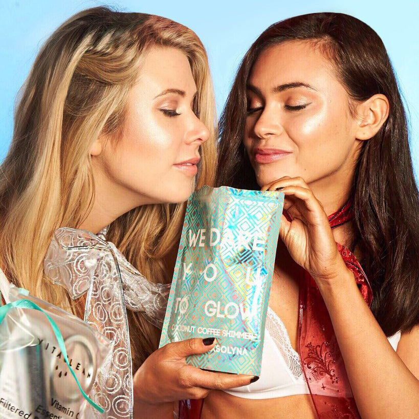 Kristina Velkova and Sara Douglas, founders of Vitaclean smelling their Coconut Coffee Shimmer product.
