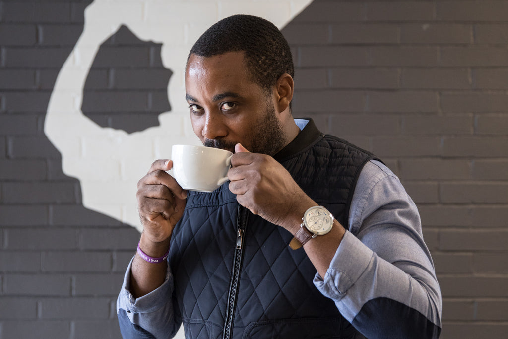 Portrait of Mike Mwenedata sipping cofffee at Rwanda Bean in Portland Oregon