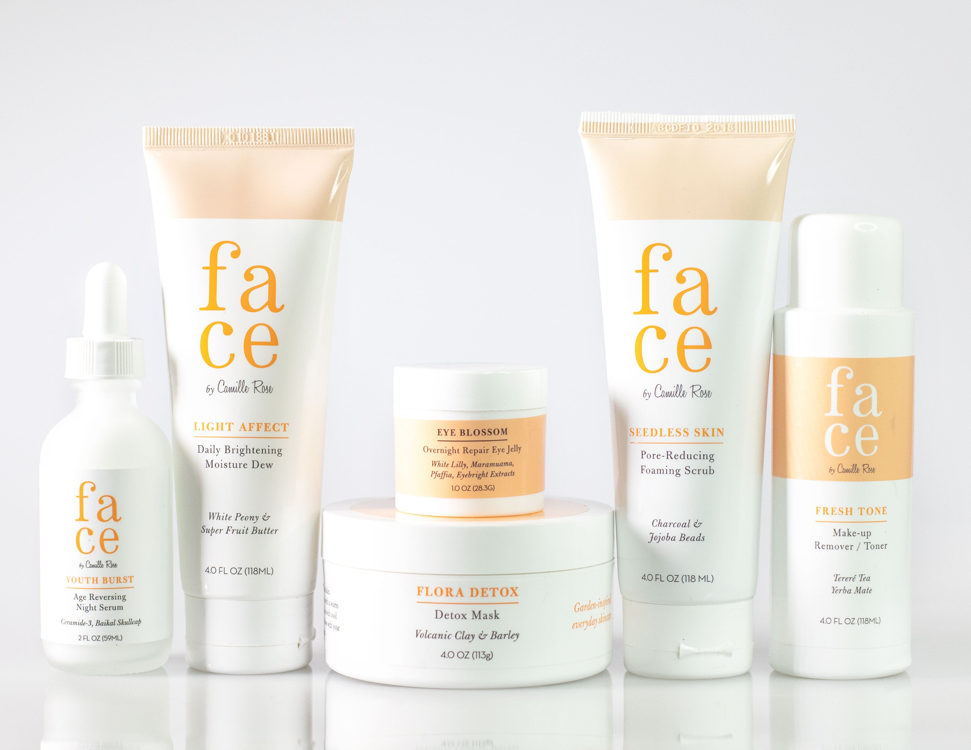 A selection of face products by Camille Rose, serums, moisturizers, masks, and creams.