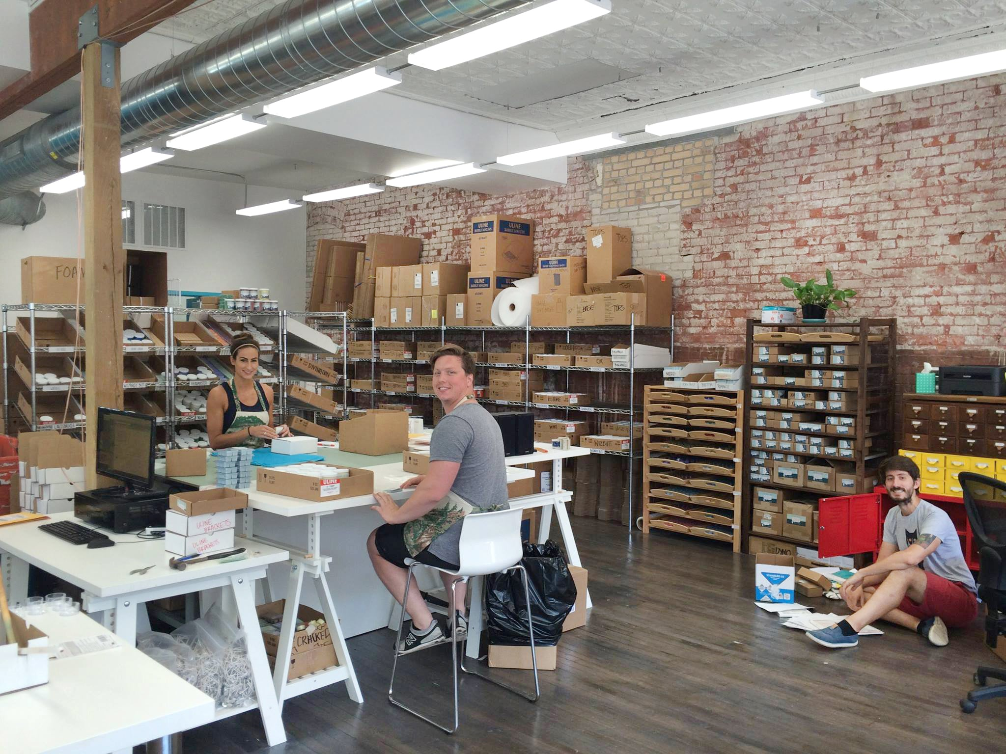 Inside Frostbeard Studio with three employees working and smiling