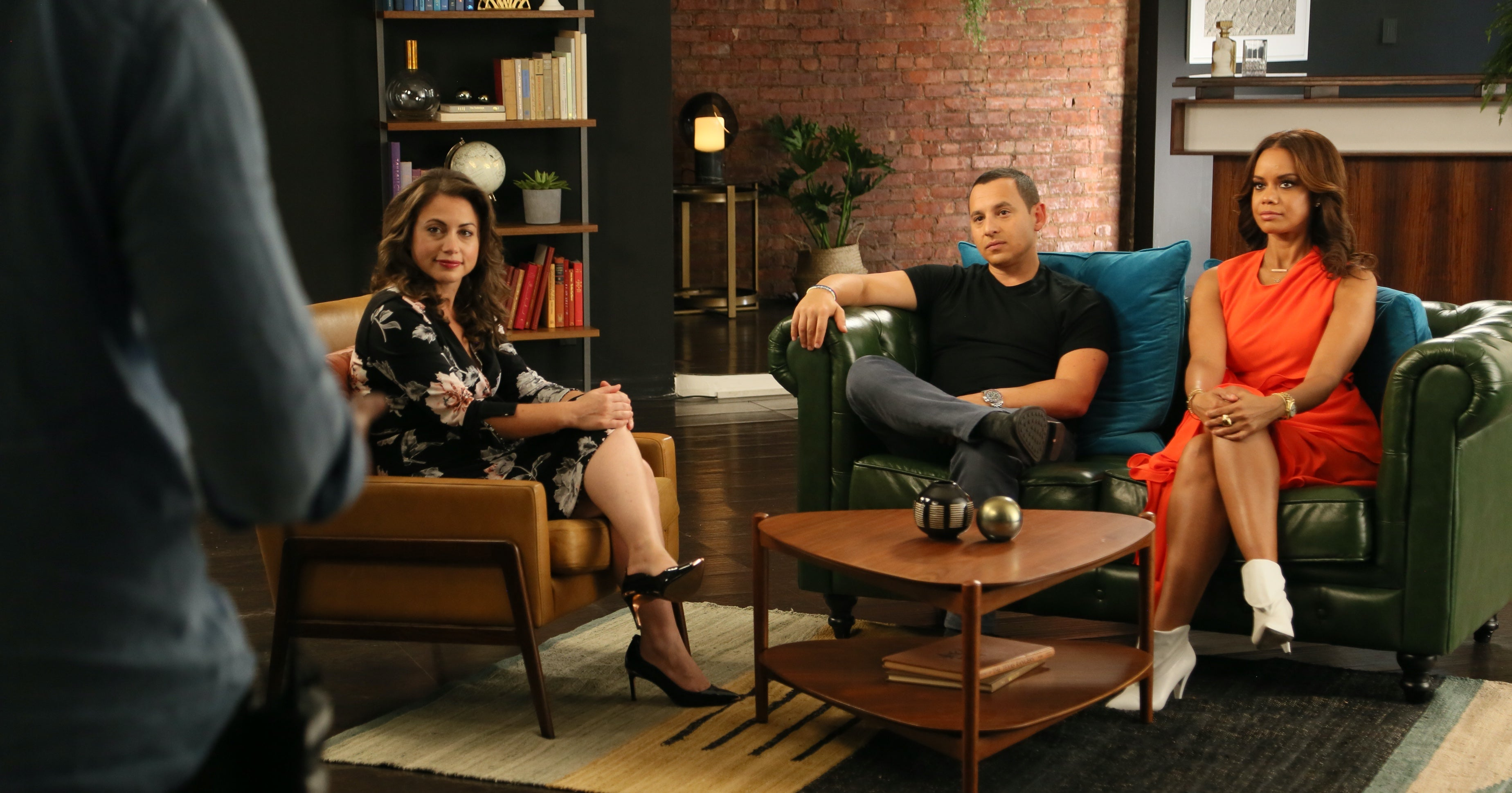 Three mentors sit on sofas listening to a pitch by an off-camera entrepreneur in the series I Quit