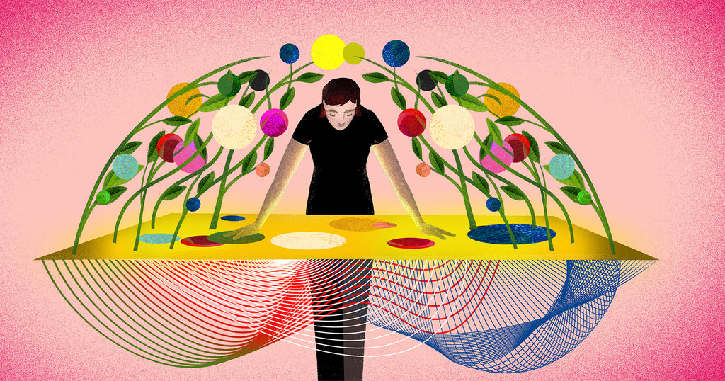 Illustration representing the creator economy: a person leans over a table while colourful shapes grow around them