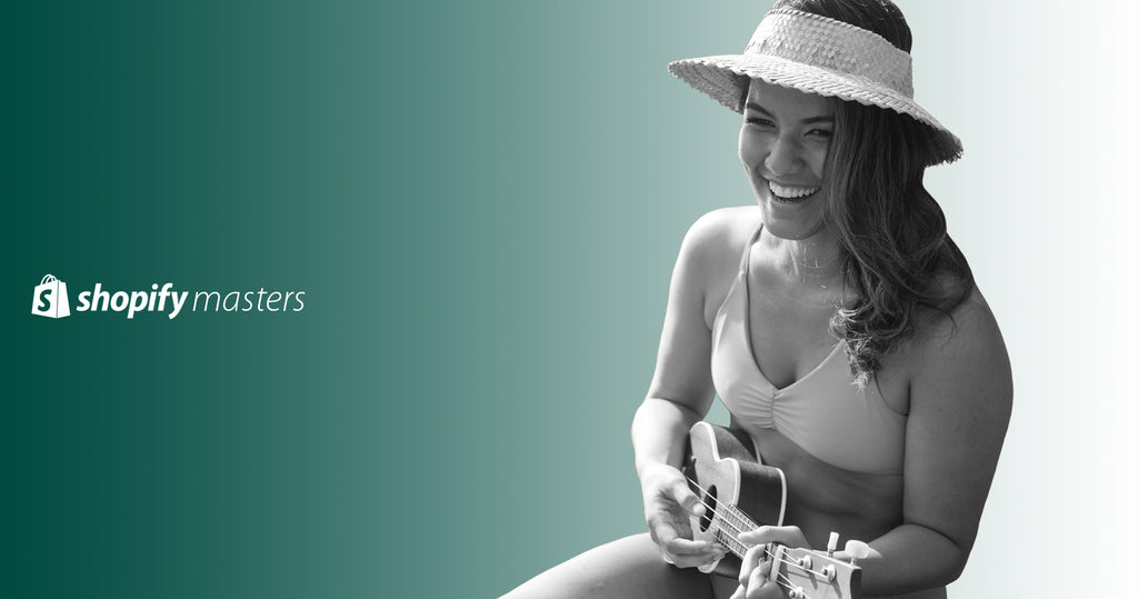 Founder of Fused Hawaii, Roxelle Cho in one of her own bikinis playing a ukulele.
