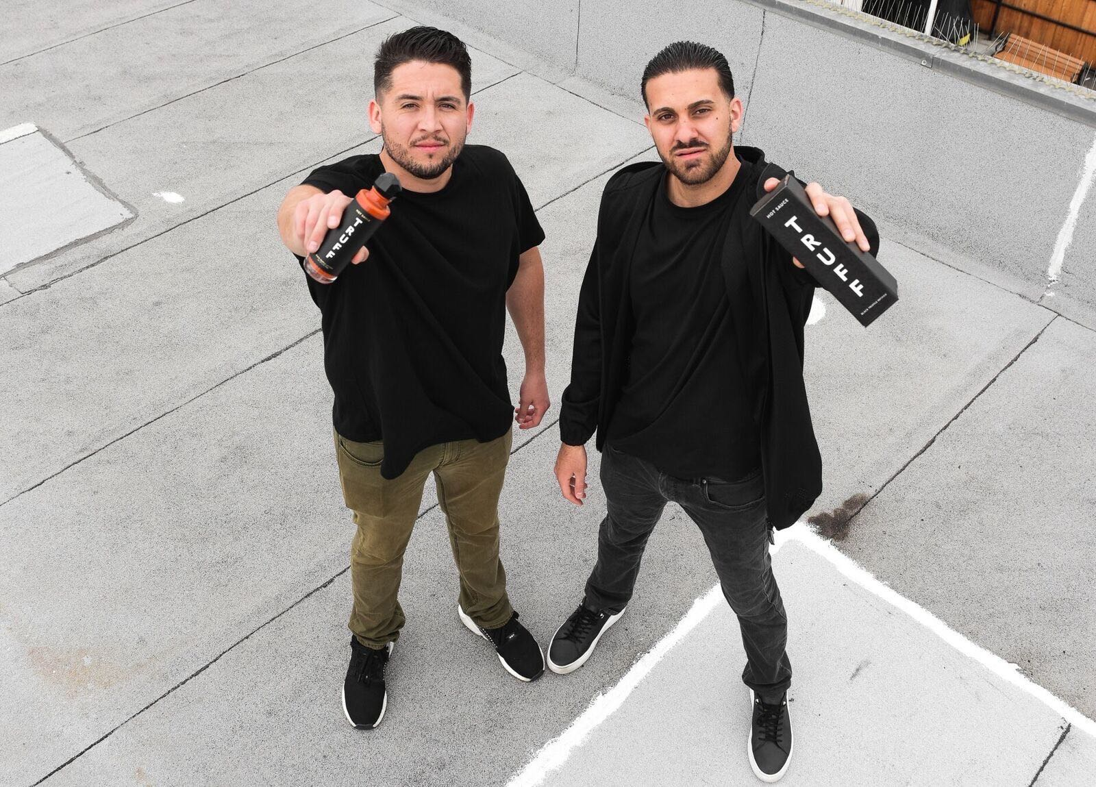 Nick Guillen and Nick Ajluni with Truff hot sauce.