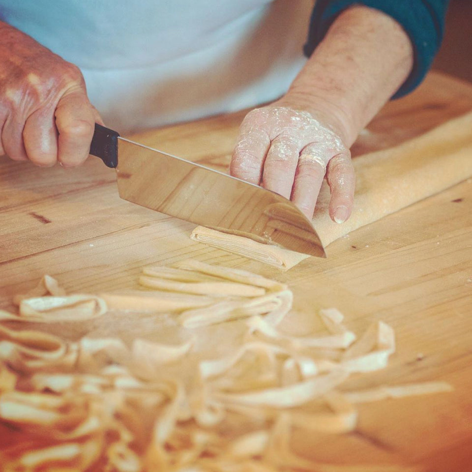 Close-up of a woman's hands making pasta from scratch