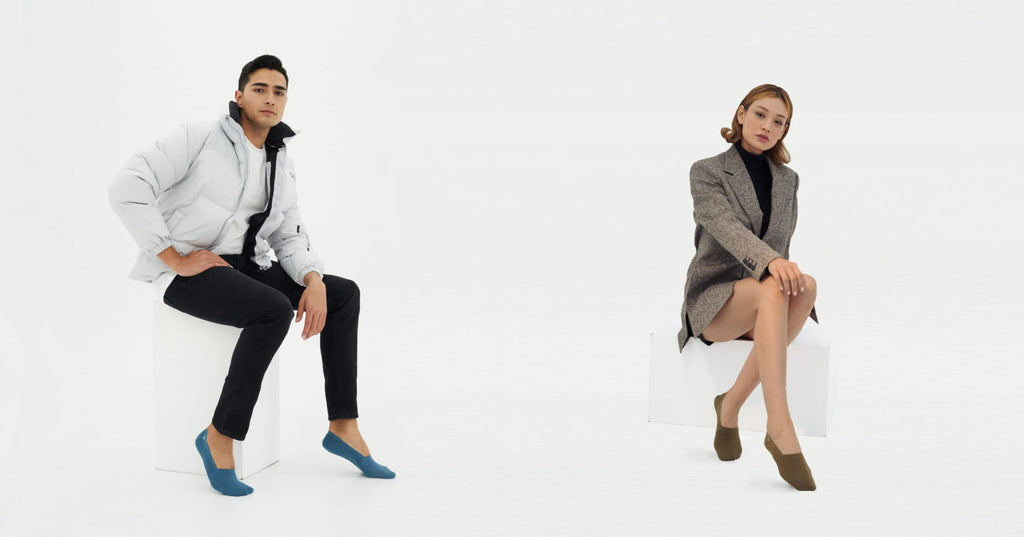 """ONDO founders posing in a white room wearing stylish """"no-show"""" socks"""
