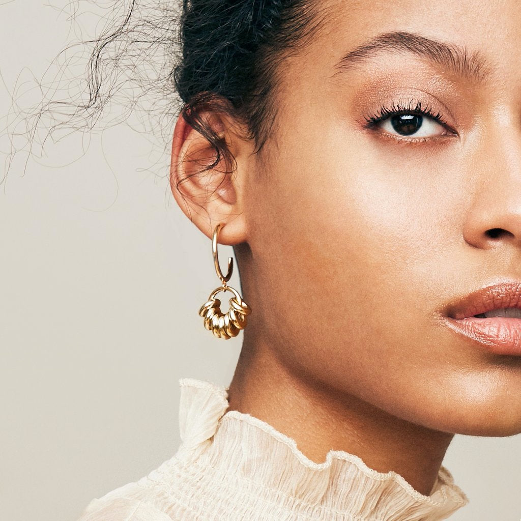 Model wearing Biko earrings