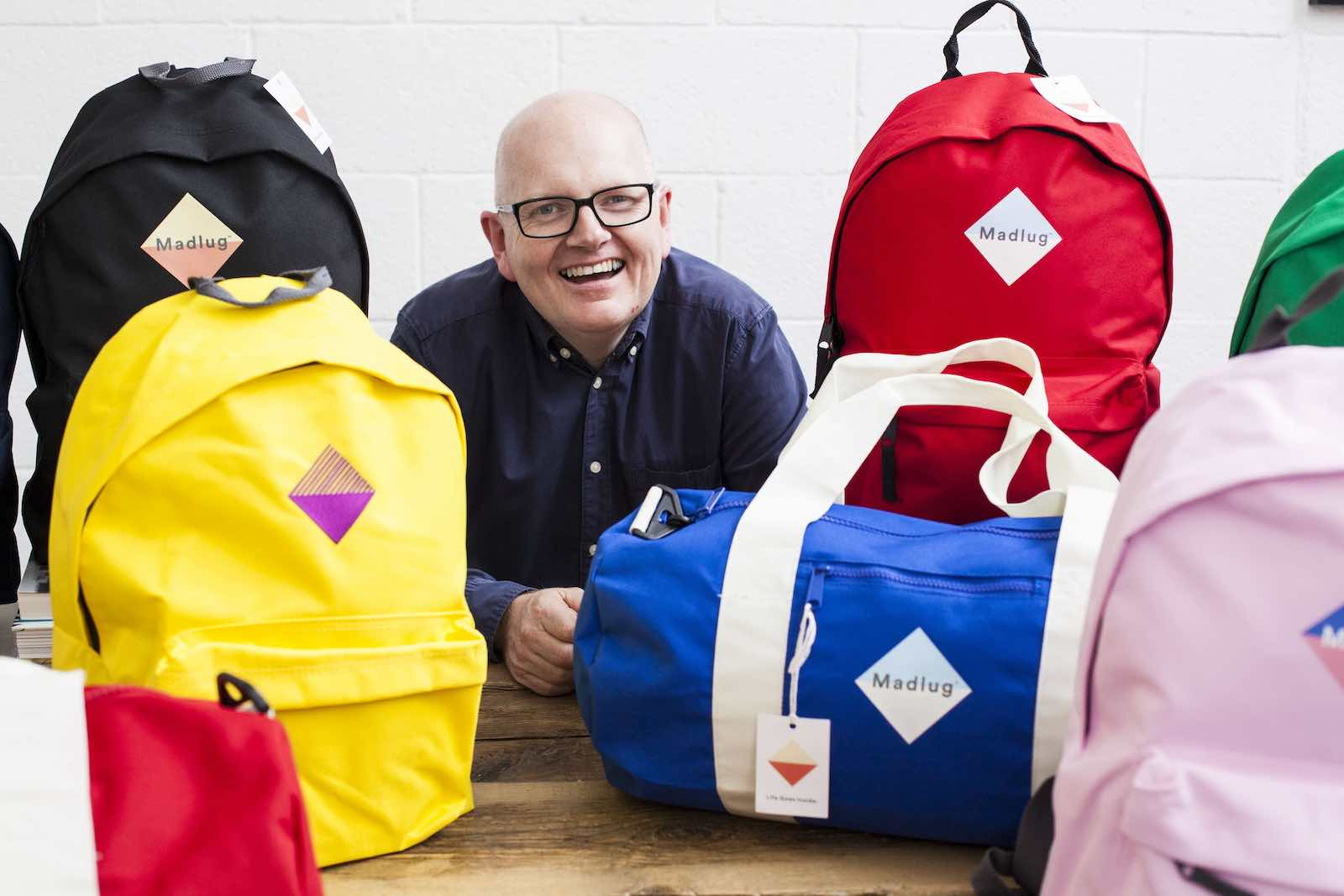 Madlug founder Dave shows off his bags. He donates one to a child in foster care for every one he sells.