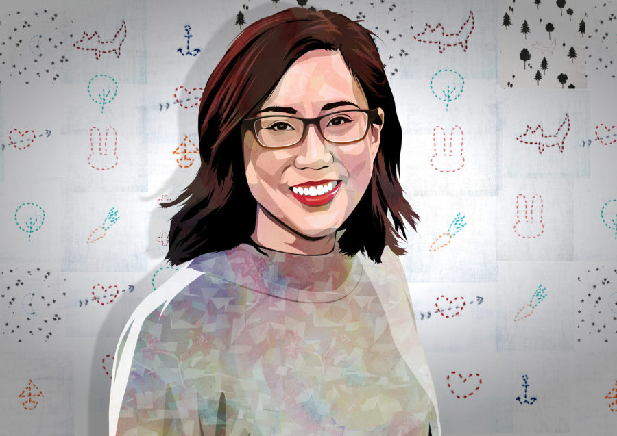 Illustration of Sarah Lin, founder of Ellie Fun Day, standing in front of a wall covered with embroidered designs.
