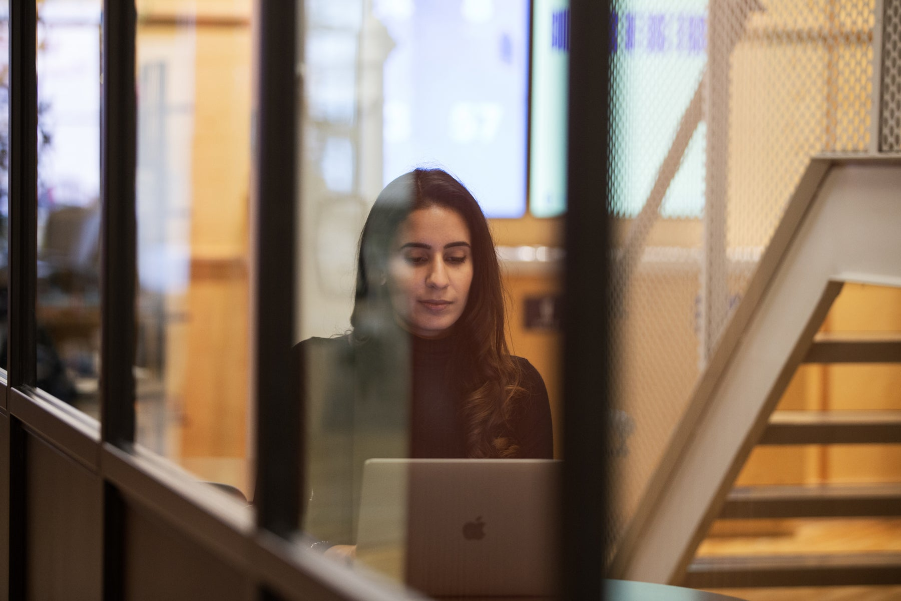 Nimi Kular, co-founder of Jaswant's Kitchen, working on her laptop at Toronto's Shopify office.