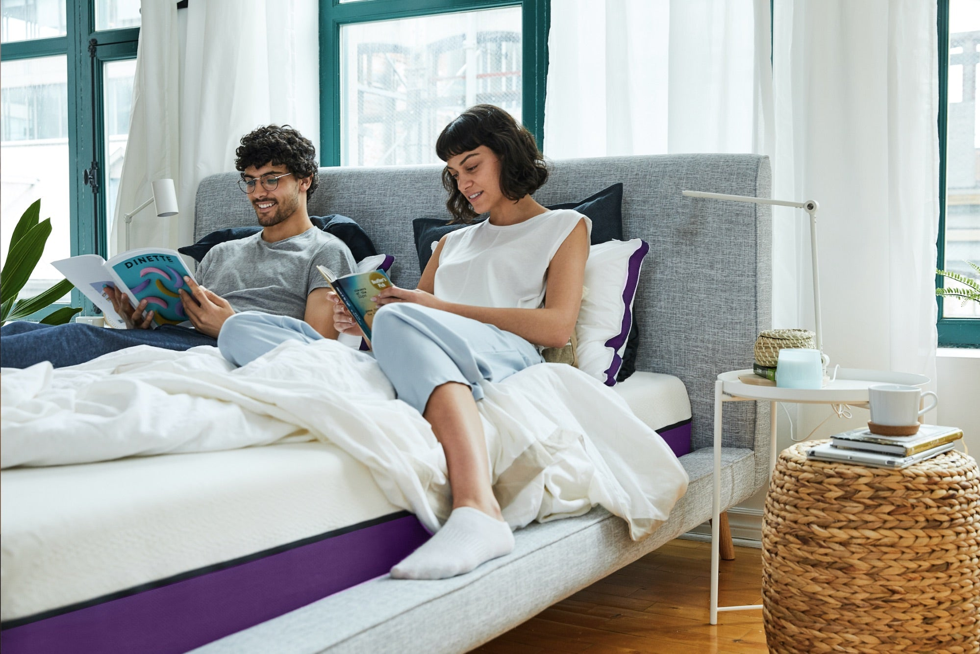 BFCM roundup, a couple sitting against the headboard of a Polysleep mattress