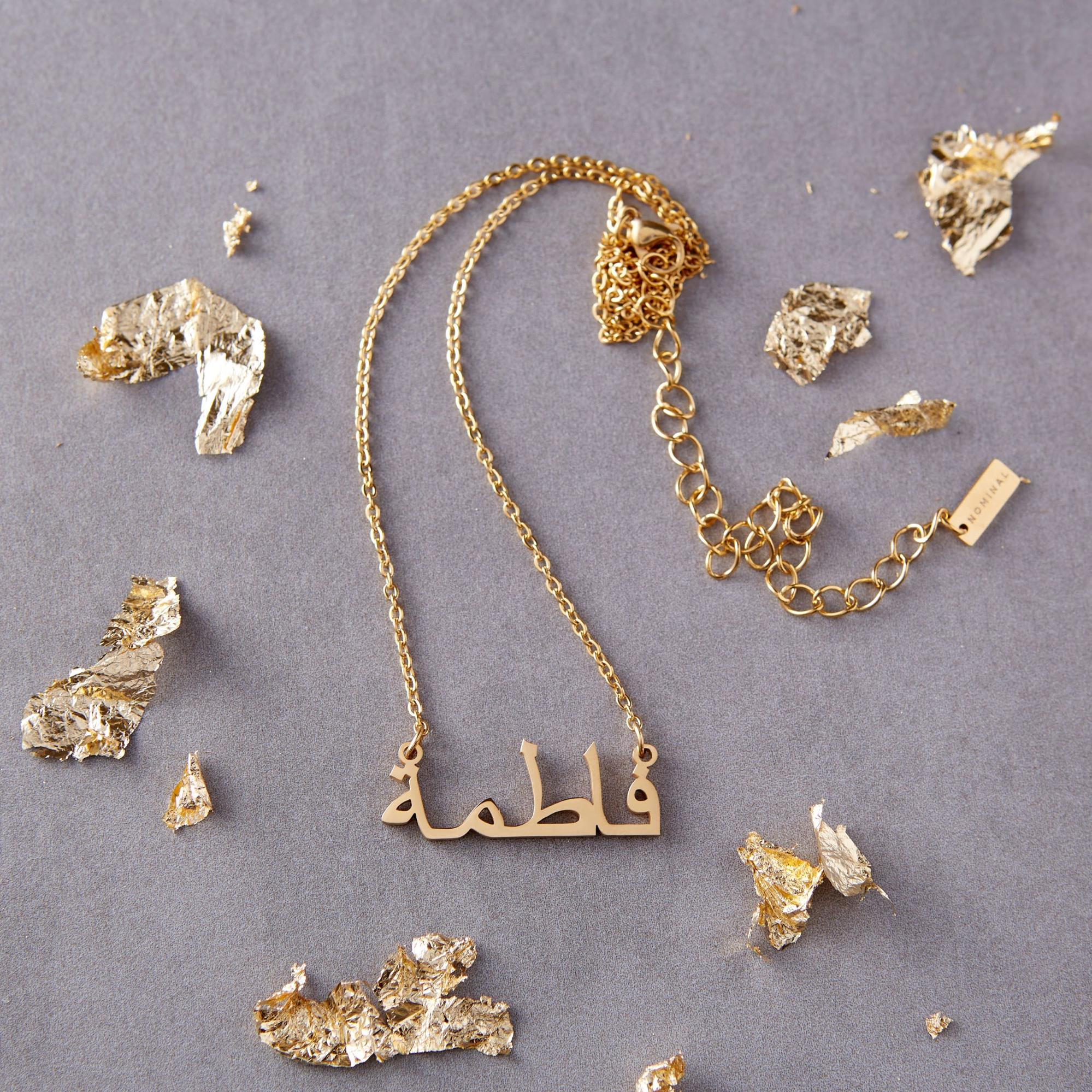 An array of golf foil pieces along with a necklace from Nominal.
