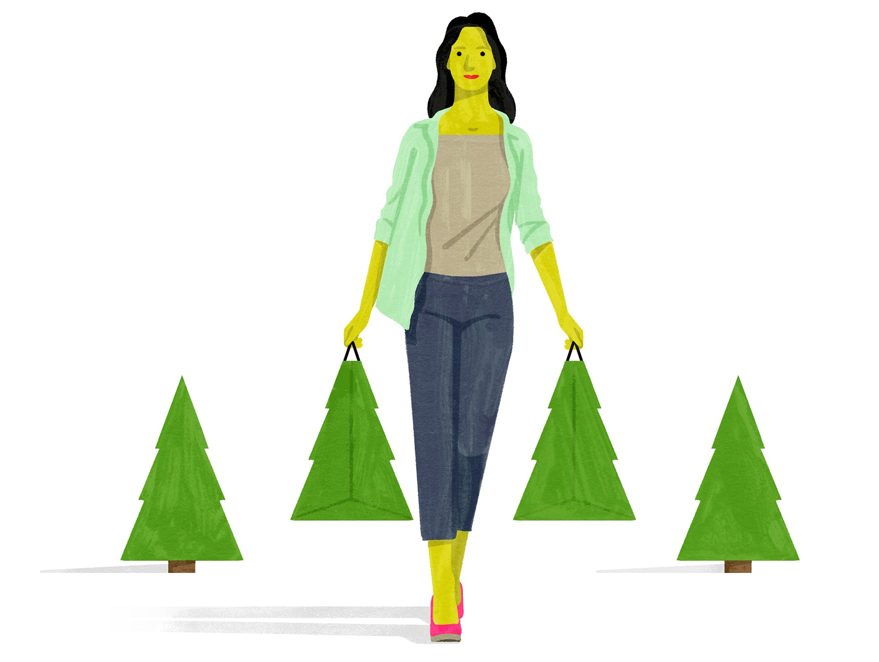 Woman carries shopping bags shaped like trees