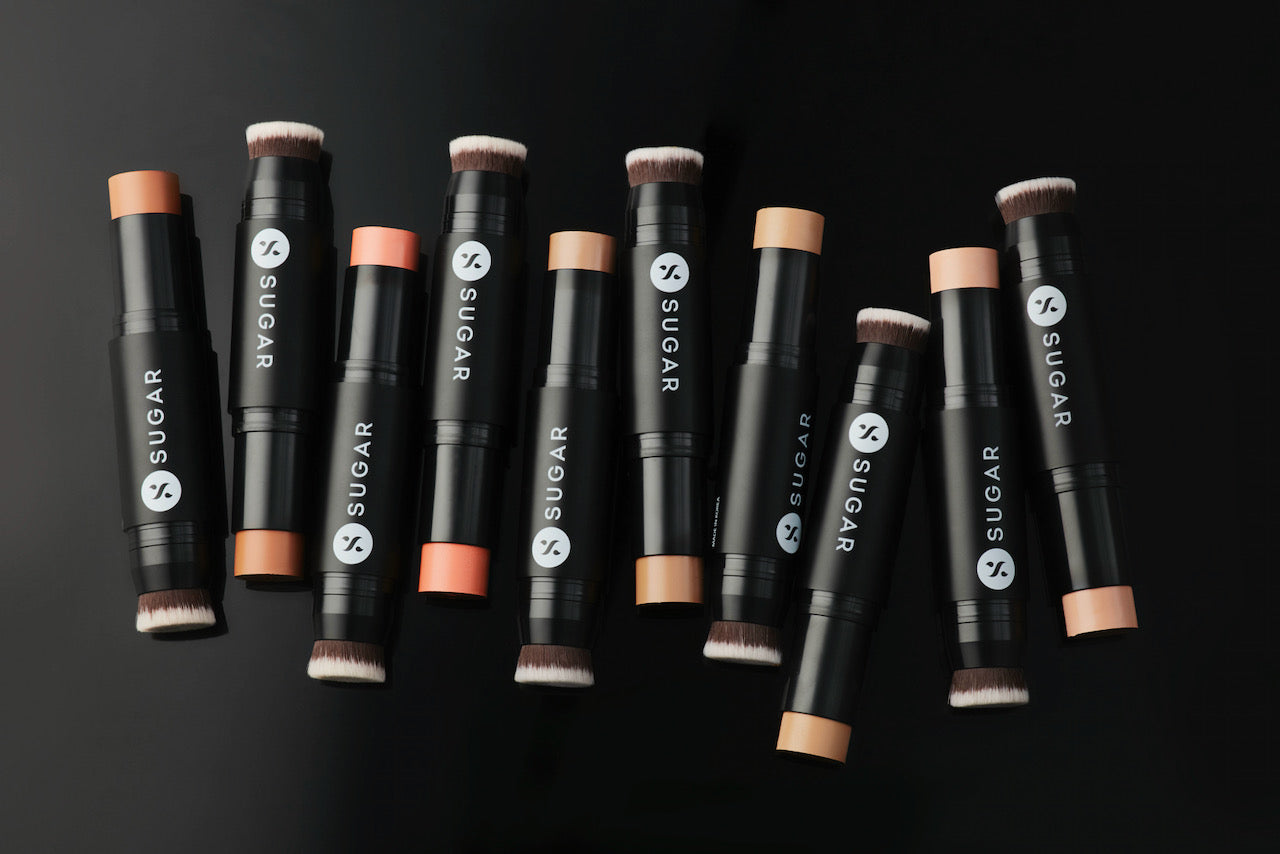 A selection of concealers by SUGAR Cosmetics against a black backdrop.
