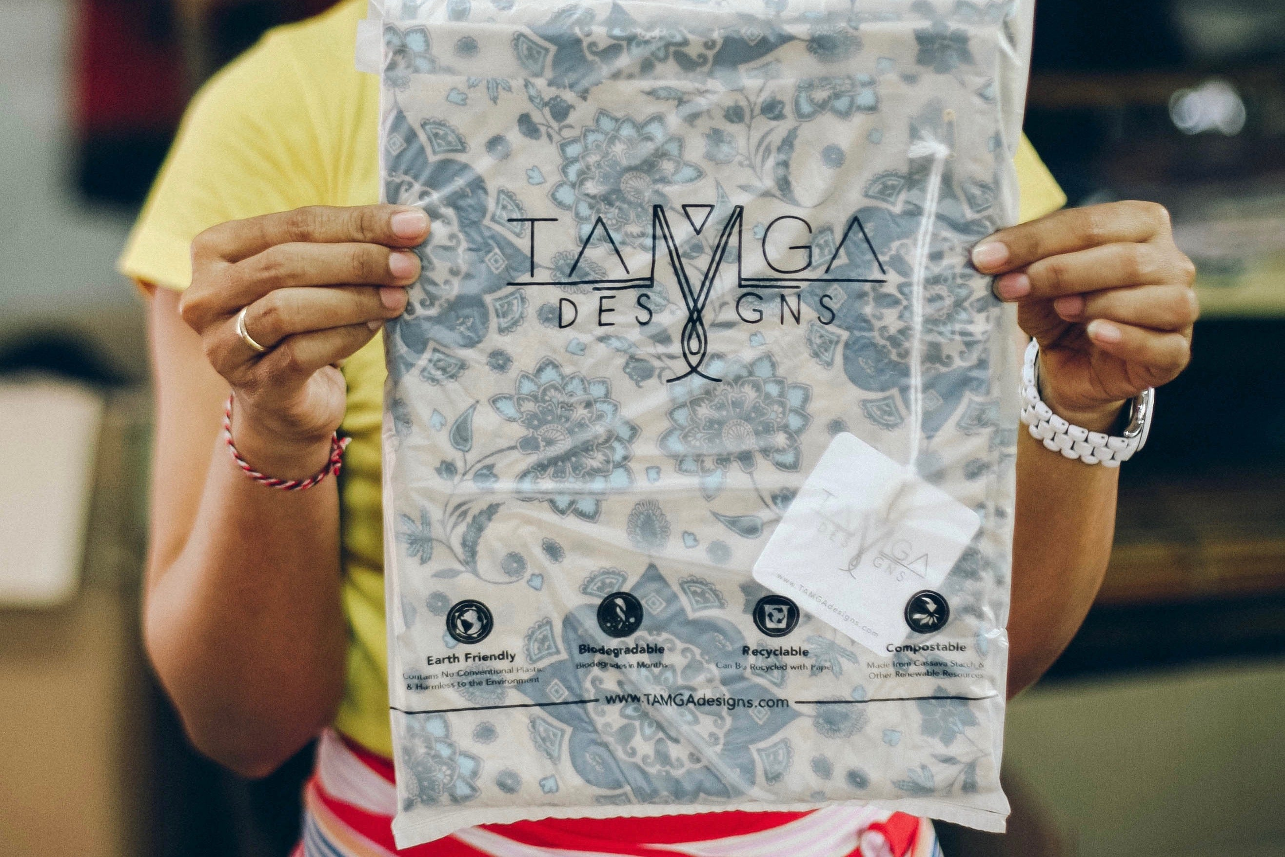 Compostable and biodegradable garment bags used by TAMGA Designs.