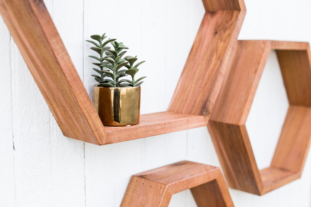 Hexagonal shelves hung on a white wall