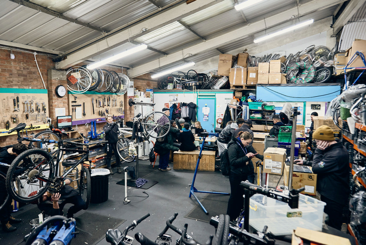 The Bike Project's workshop filled with customers, volunteers, and mechanics.