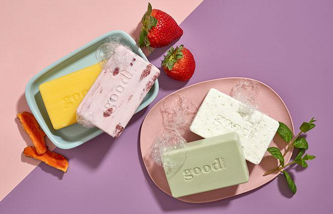 Bar soaps staged with fresh fruits and herbs