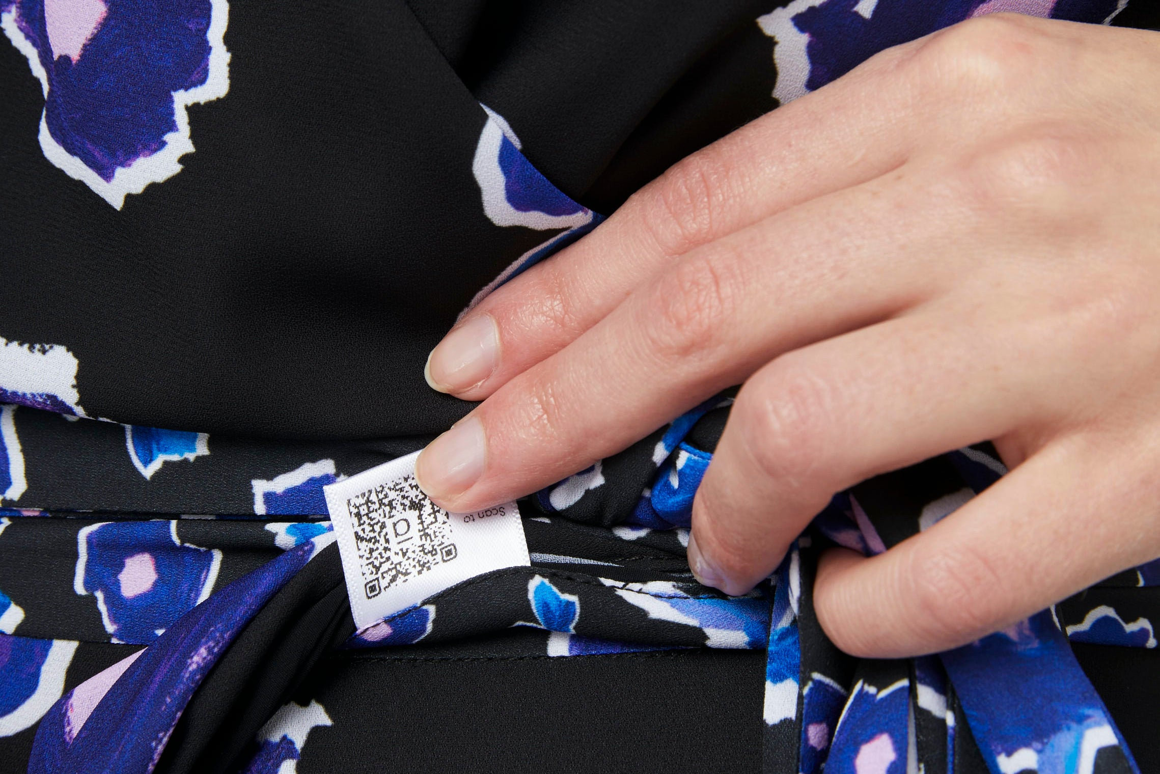 Close up of a QR code printed on a dress label