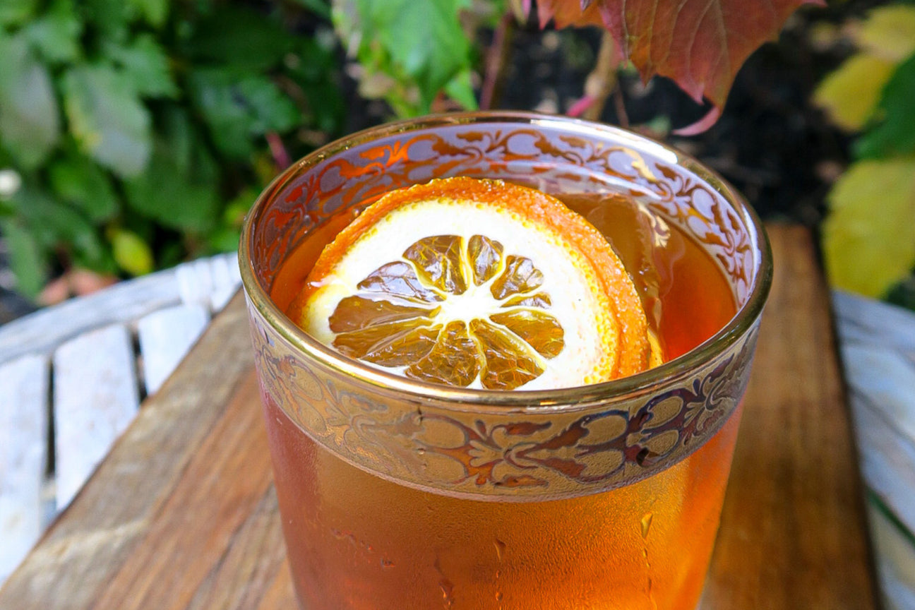 Close up of a cocktail with an orange slice