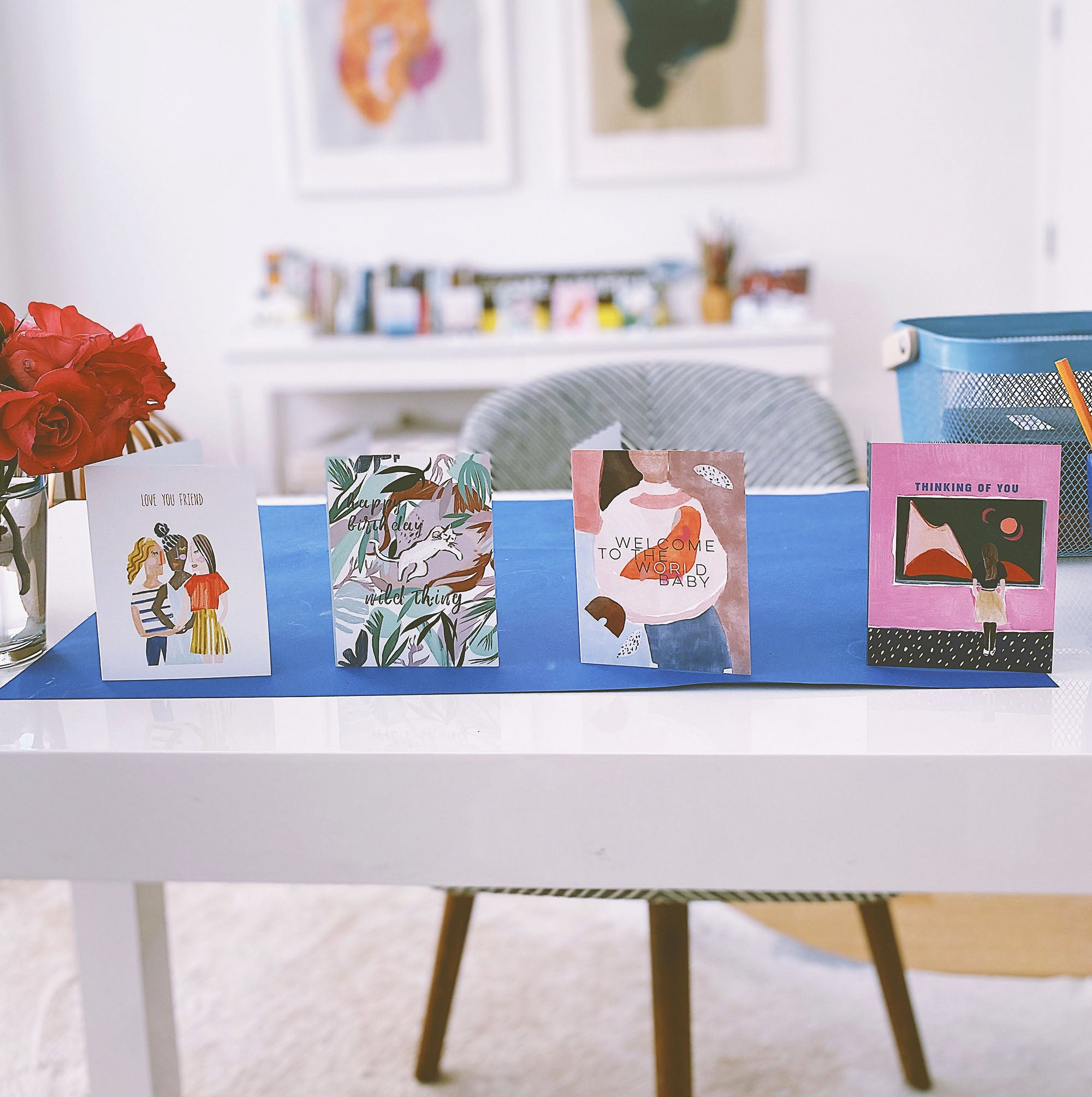 Illustrated stationery sits on a desk