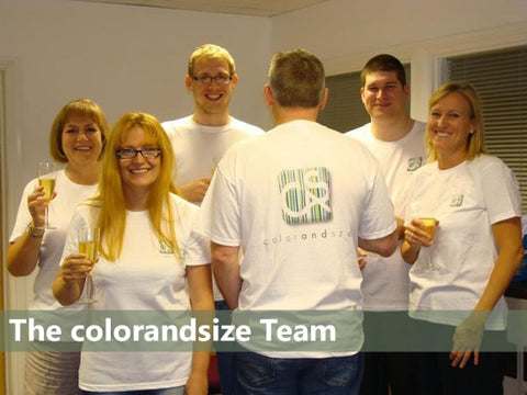 Photo of the colorandsize team, holding champagne flutes