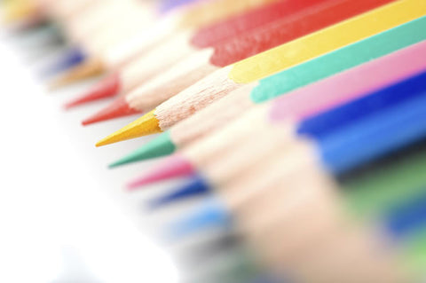 Close-up shot of colored pencils line in a row