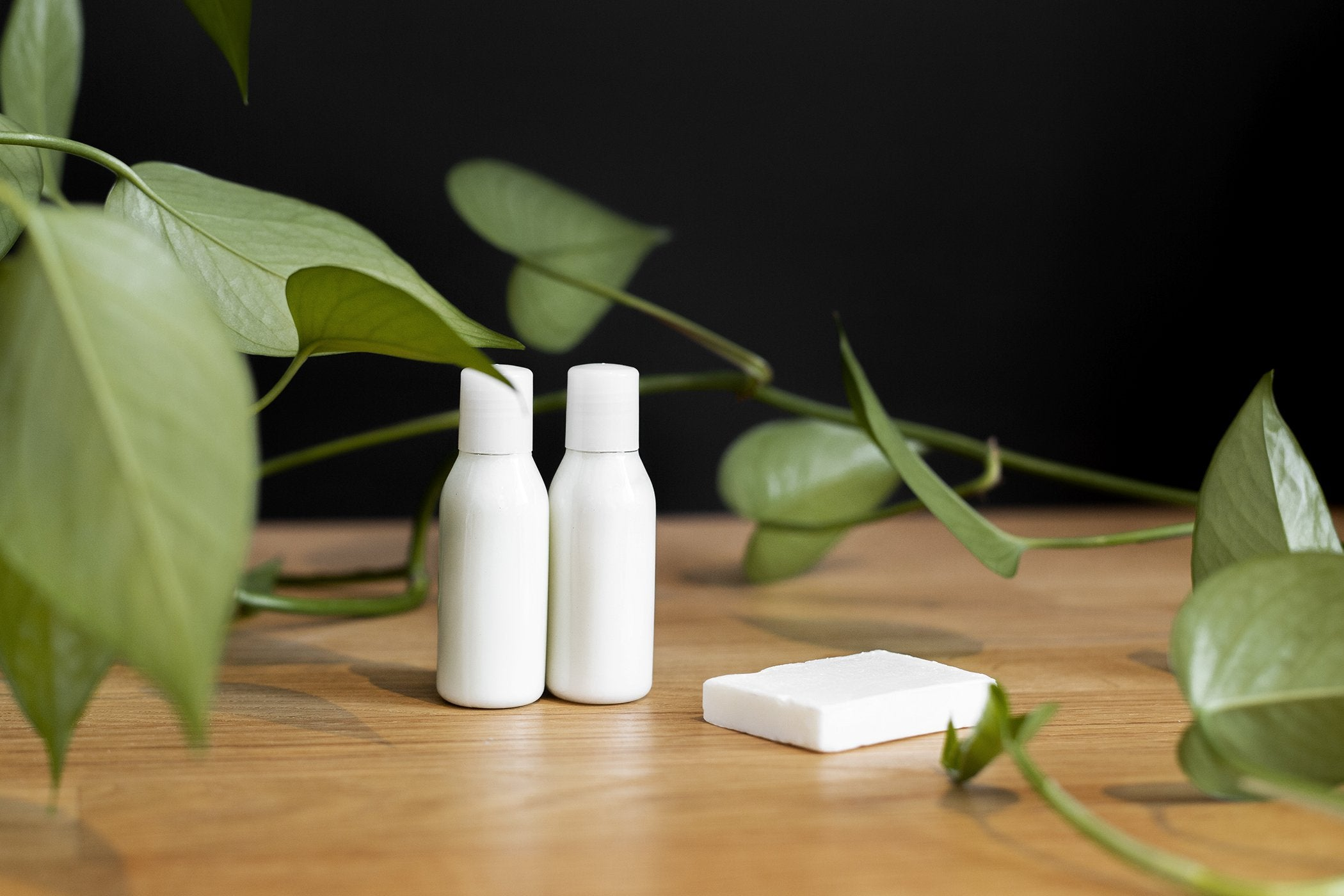 White label skincare products sit on a wooden surface