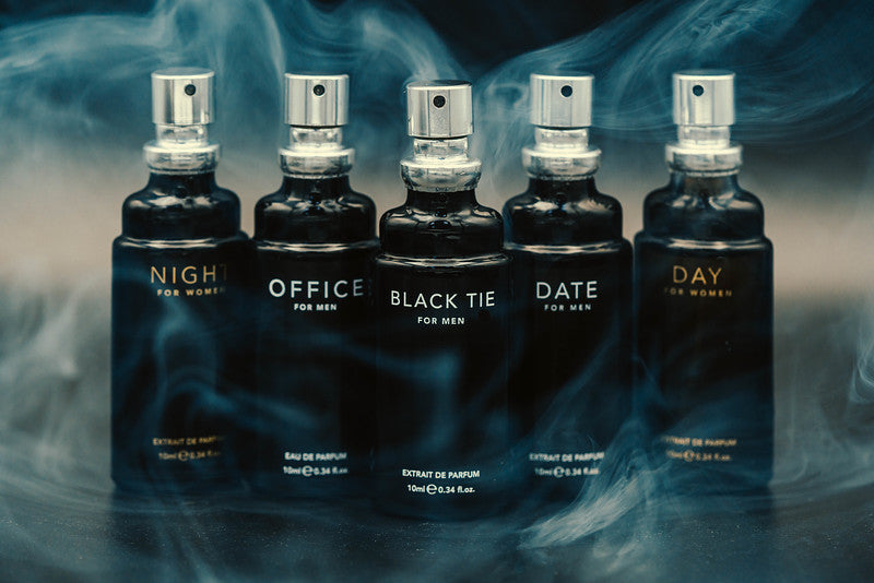 An array of scents by Fragrance One against a blue and hazy background.