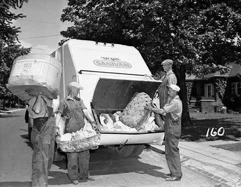 Old black and white photo of 1950s garbage collectors