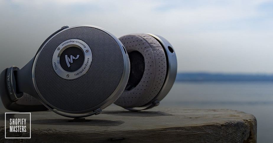 A pair of headphones resting on a wooden surface.