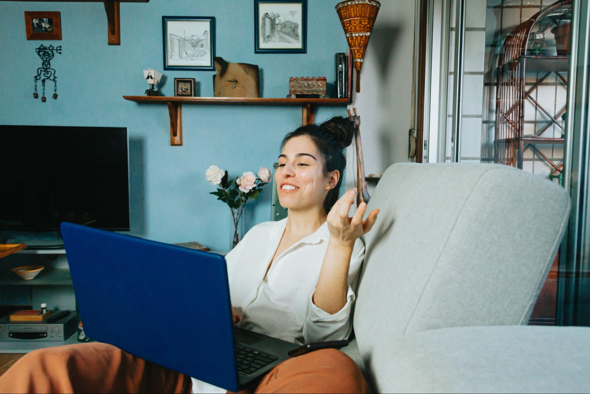 person-smiling-while-talking-into-their-laptop-screen