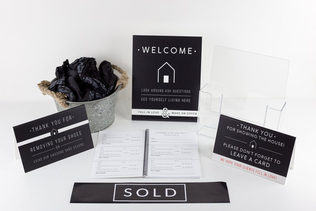 A bundle of signage from All Things Real Estate