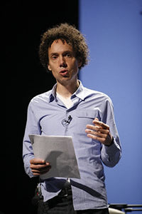 Photo of Malcolm Gladwell speaking at PopTech 2008. Photo by Kris Krug.
