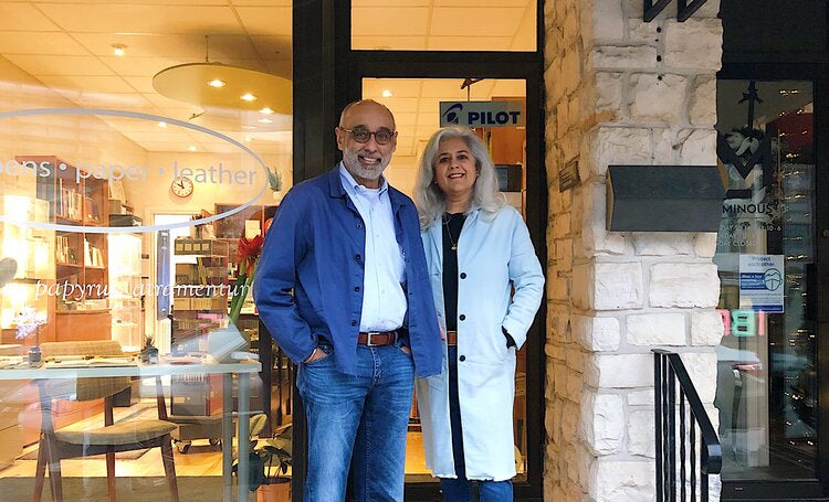 Mano and Baldeep Duggal stand in front of their store, Phidon Pens.
