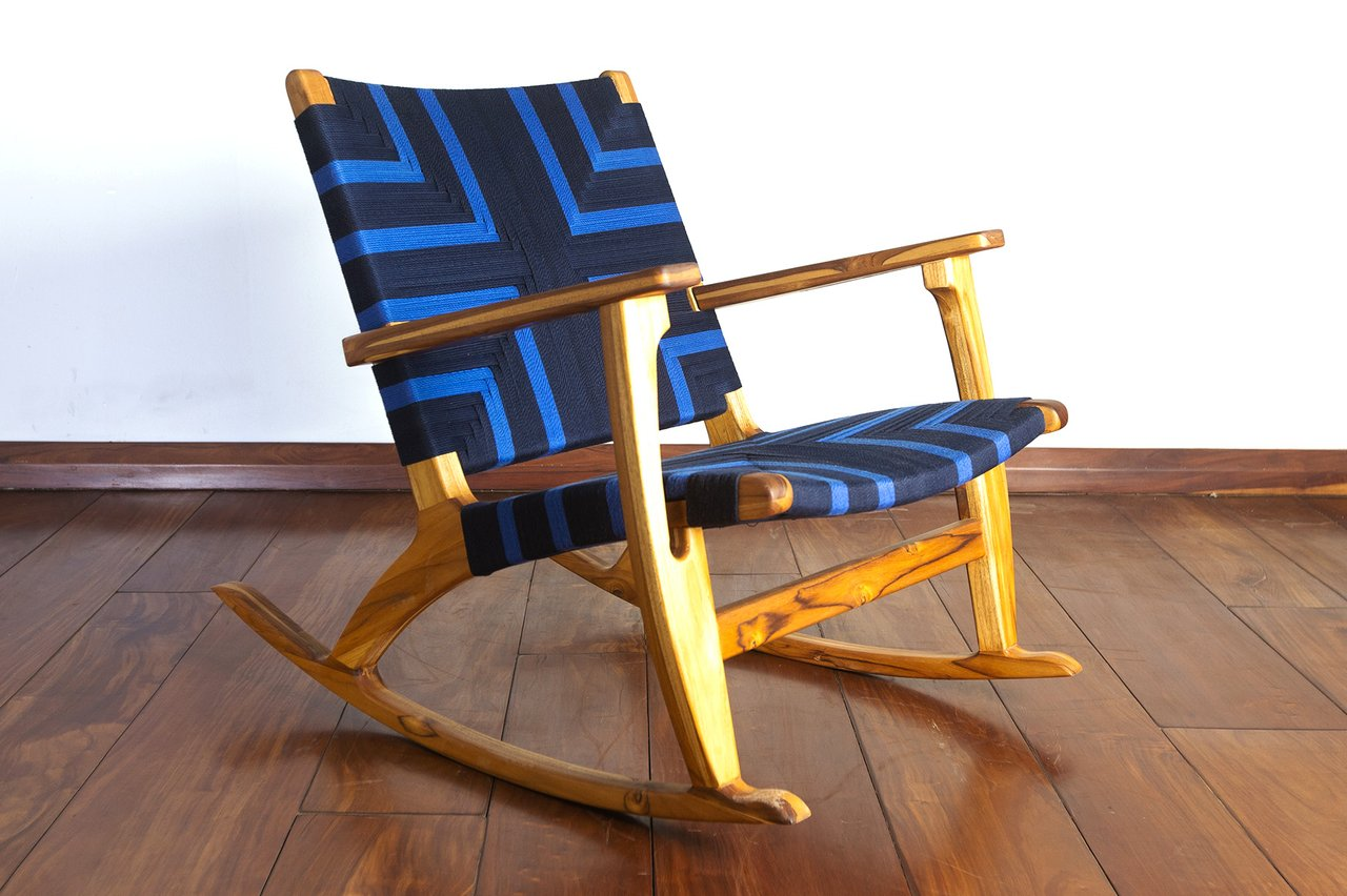 Wooden rocking chair with woven seat