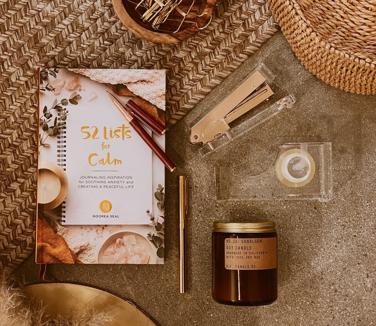 Moorea Seal calm package: candle, book (52 Lists for Calm), pens, jewellery, tape and a stapler
