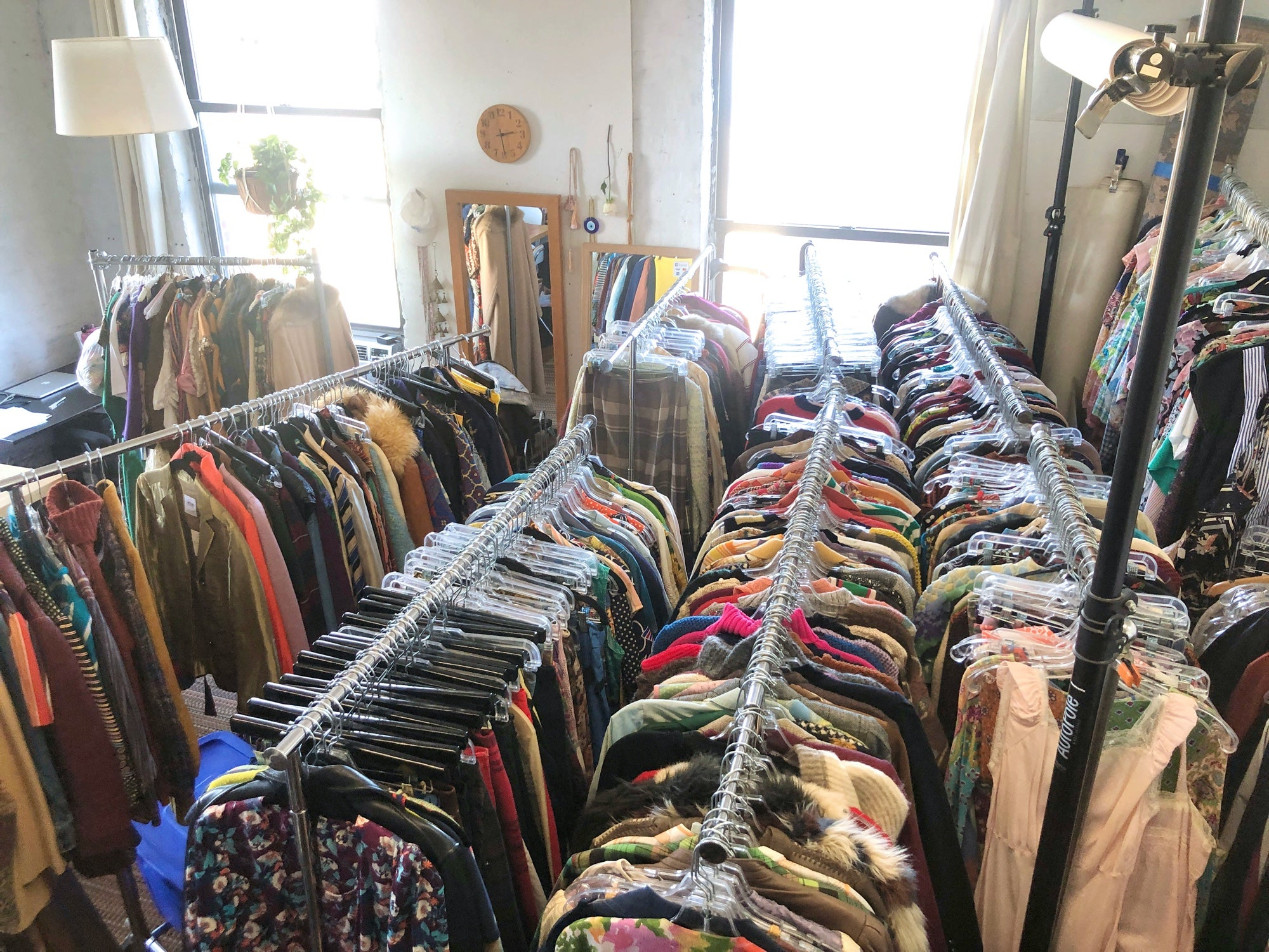 Room filled with racks of vintage clothing