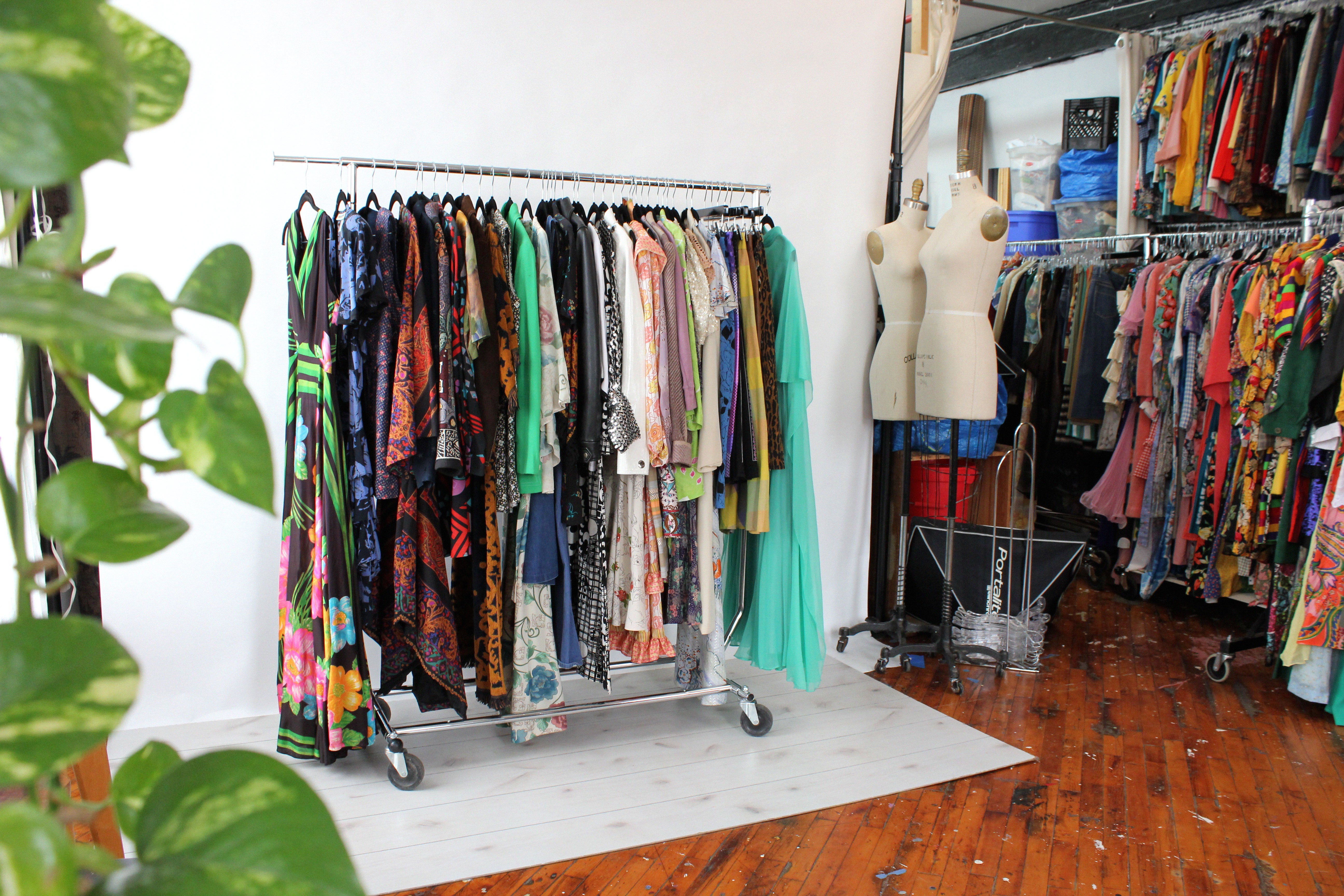 A retail shop with a display of vintage clothing on a rack