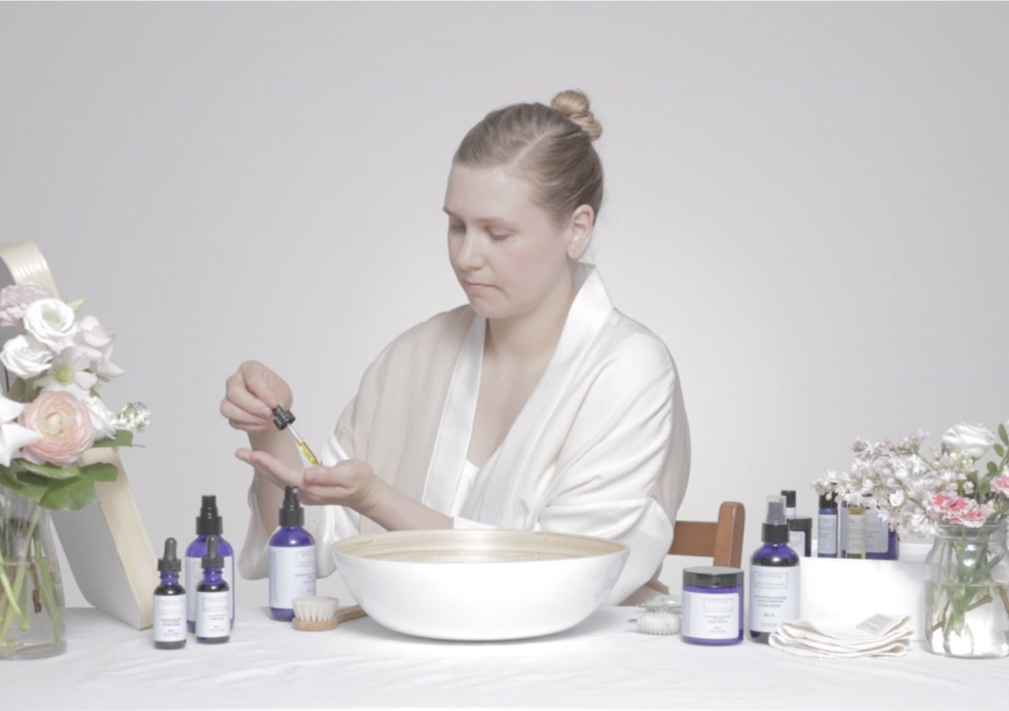 Julie Clarke the founder of Province Apothecary using some of her products to showcase her daily skincare routine.
