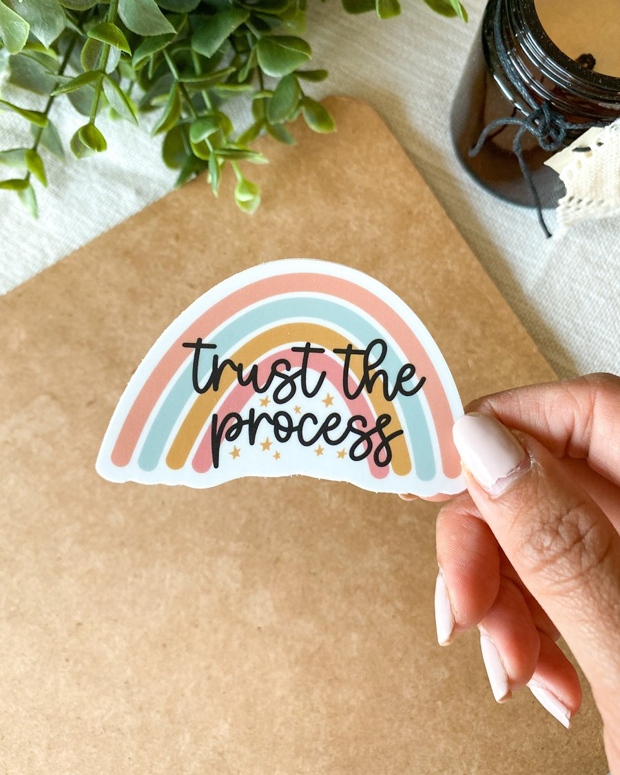 A sticker that says 'trust the process.'