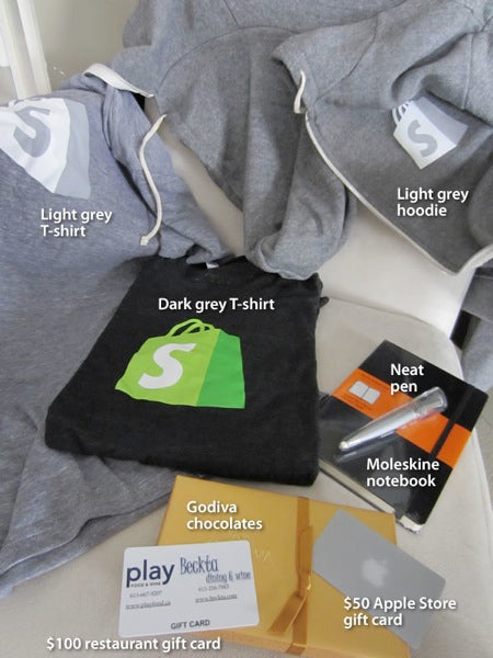 Even more Shopify standard issue gear: Light grey Shopify t-shirt, dark grey Shopify t-shirt, light grey Shopify hoodie, neat pen, Moleskine notebook, Godiva chocolates, $100 restaurant gift card, $50 Apple Store gift card