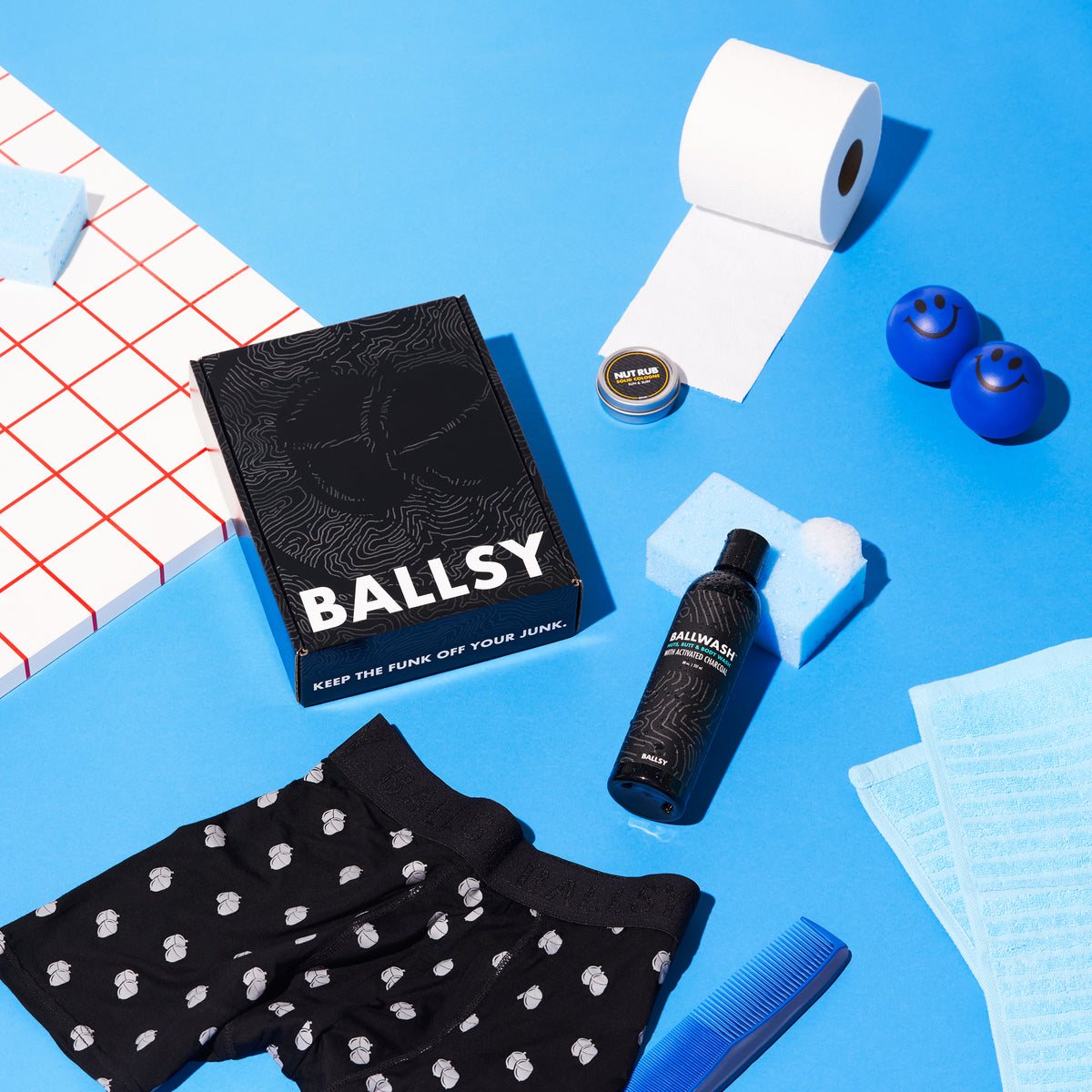 A package from Ballsy next to a pair of boxers and other bathroom items.