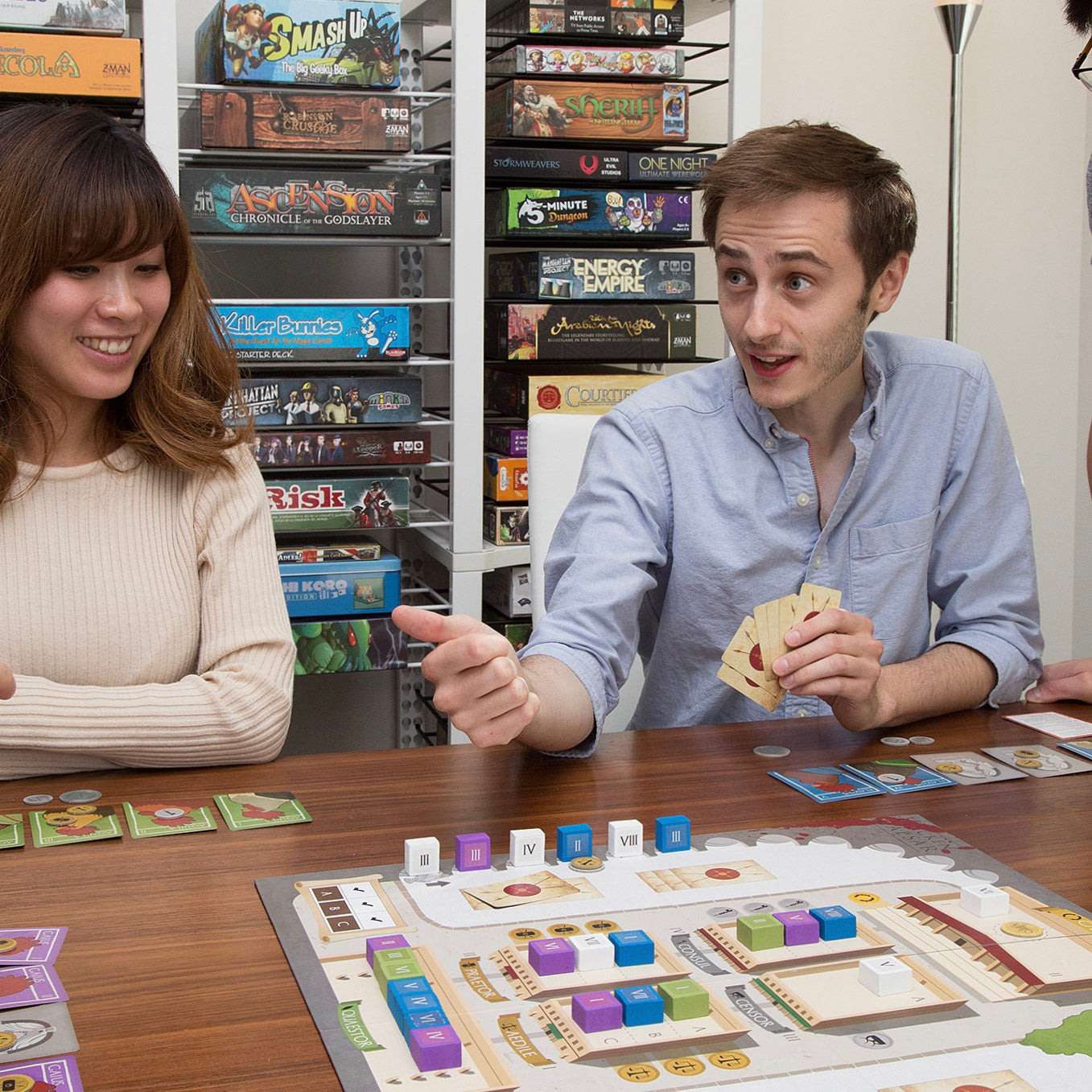 Dan Blacklock, founder of BoxThrone playing a board game with friends.