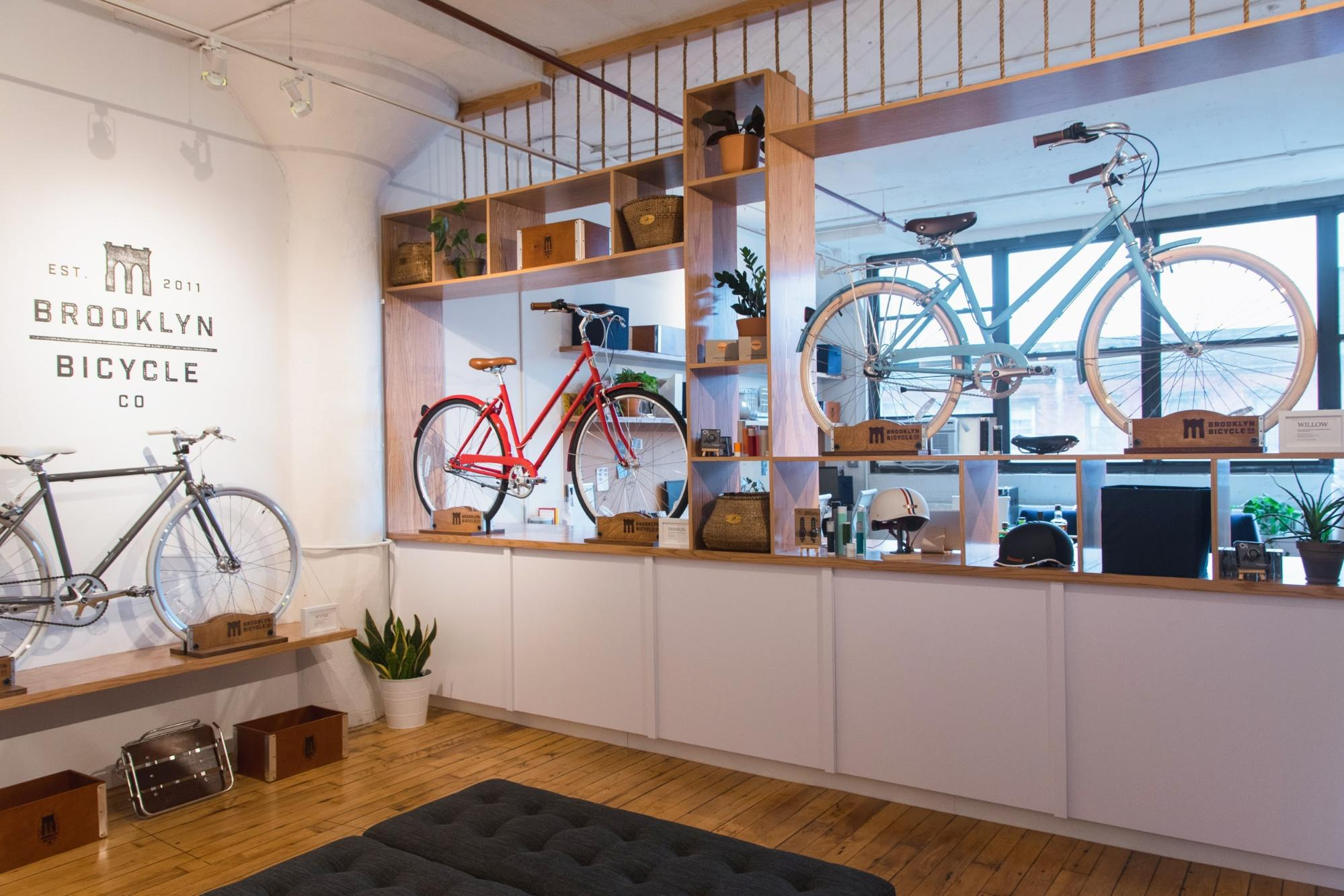 Three bikes displayed within the showroom of Brooklyn Bicycle Co.