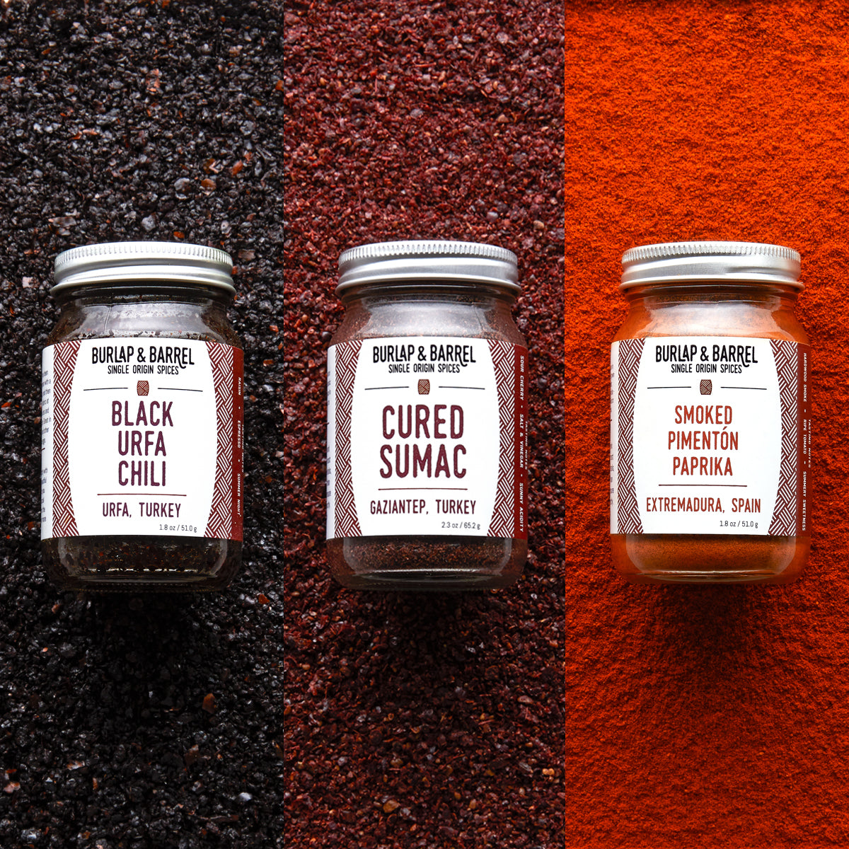 Chili, sumac, and paprika spice bottles by Burlap & Barrel backdropped by each raw ingredient.