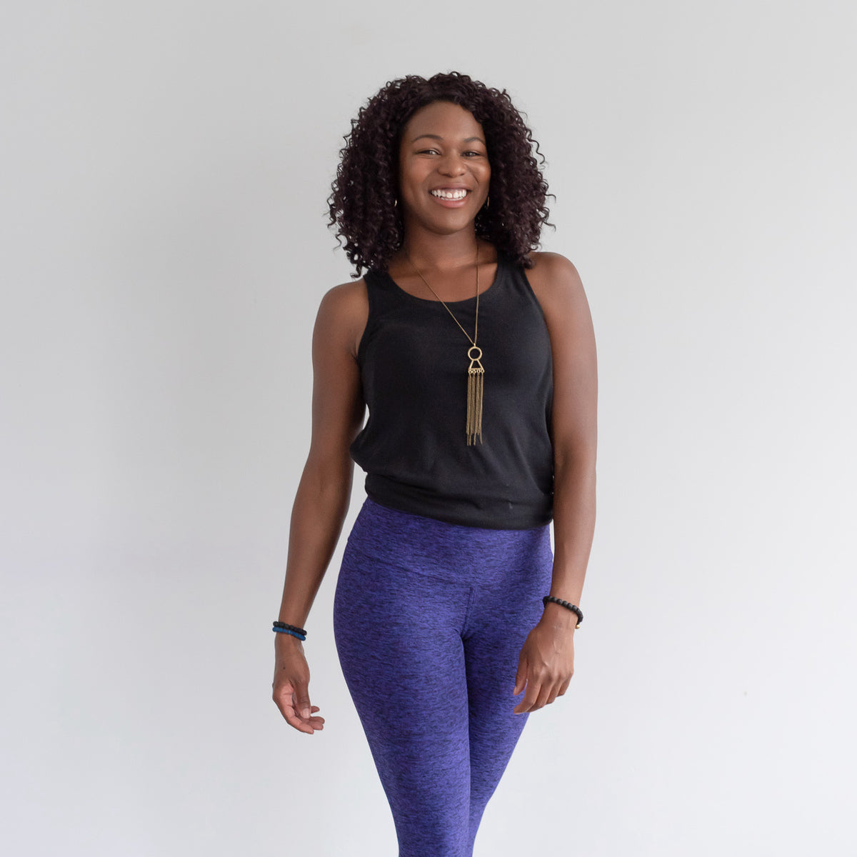 A model wearing a set of active wear by Buttercream Clothing.