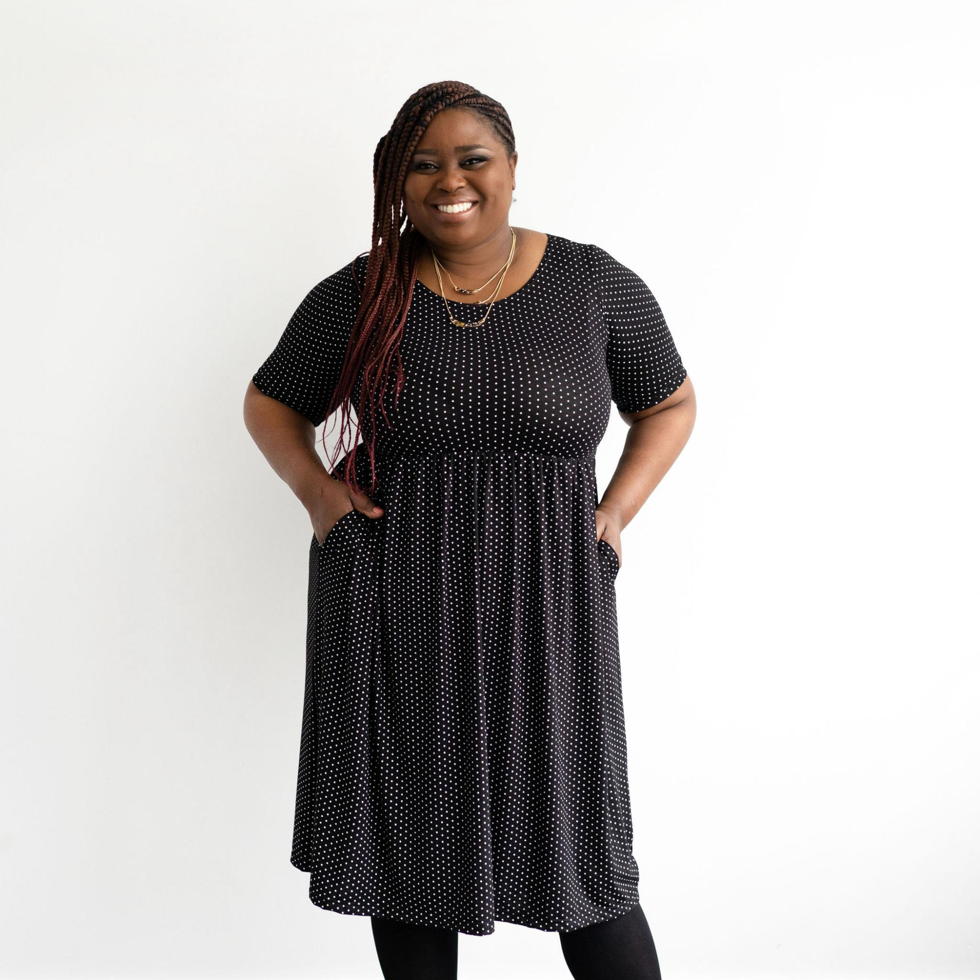 A model wearing a dress from Buttercream Clothing.